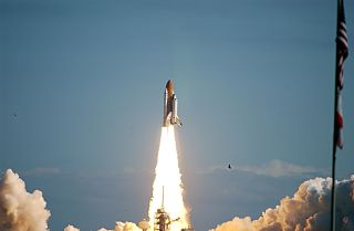 Space Shuttle Columbia hurtles through a perfect blue Florida sky following a flawless and uneventful countdown. Liftoff of Columbia on mission STS-107 occurred on-time at 10:39 a.m. EST on Jan. 16, 2003.