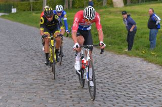 WAREGEM BELGIUM APRIL 03 Mathieu van der Poel of The Netherlands and Team CorendonCircus Anthony Turgis of France and Team Direct Energie Taaienberg Cobblestones during the 74th Dwars door Vlaanderen 2019 a 1828km race from Roeselare to Waregem DwarsdrVlaander FlandersClassic on April 03 2019 in Waregem Belgium Photo by Tim de WaeleGetty Images