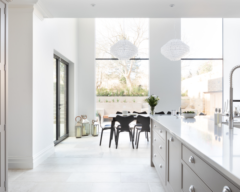 open plan white kitchen with big windows - increase the value of your home