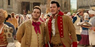 LeFou (Josh Gad) and Gaston (Luke Evans) look ahead in Beauty and the Beast (2017)