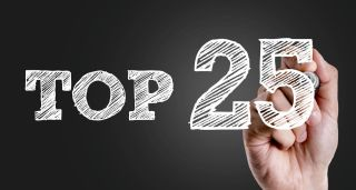 "Photo Illustration: Hand writing ""Top 25"" in white marker on dark background"