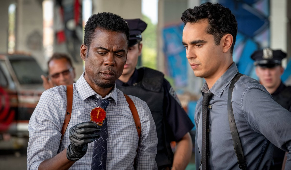 Chris Rock and Max Minghella examine a piece of evidence in Spiral: From the Book of Saw.