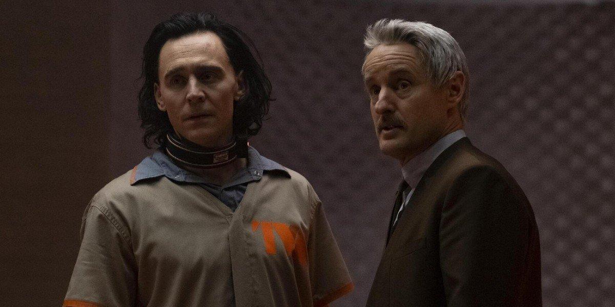 Loki (Tom Hiddleston) and Mobius M. Mobius (Owen Wilson) stare off on Loki (2021)