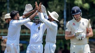 Sri Lanka Board President's XI Ramesh Mendis (2L) celebrates with his teammates after he dismissed England's Dom Sibley (R) during the opening day of a four-day practice match between Sri Lanka Board President's XI and England at the P. Sara Oval Cricket Stadium in Colombo on March 12, 2020.