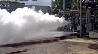 The first hotfire test of Blue Origin's BE-7 engine took place June 18 on a test stand at NASA's Marshall Space Flight Center.