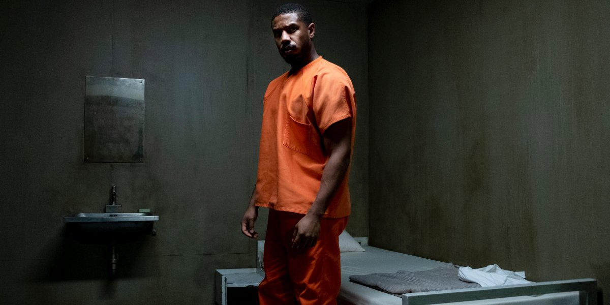 Michael B. Jordan staring at his cell door in Without Remorse.