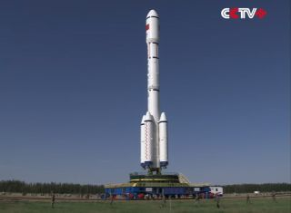 This still image from a state-run CCTV newscast shows the Long March 2F rocket carrying China's Tiangong-2 space lab rolling out to the launch pad for a mid-September 2016 launch.