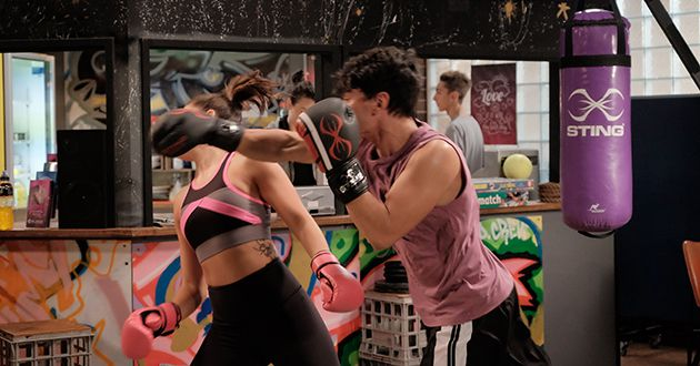 Paige Willis is knocked out while boxing in Neighbours