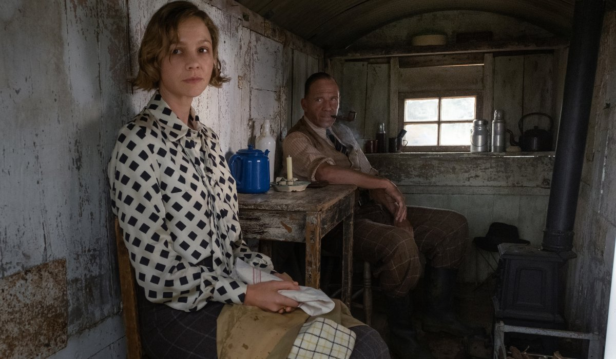 The Dig Carey Mulligan and Ralph Fiennes sitting in a shack at tea