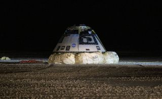 Boeing's first CST-100 Starliner spacecraft on the ground at White Sands Missile Range in New Mexico, shortly after landing on Dec. 22, 2019.