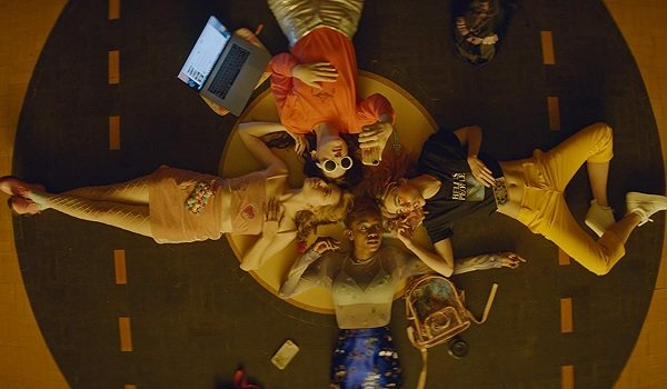 Assassination Nation the girls lay down in a circle on a comfy cushion