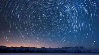 Best intervalometers: Image shows star trails over snowy mountains