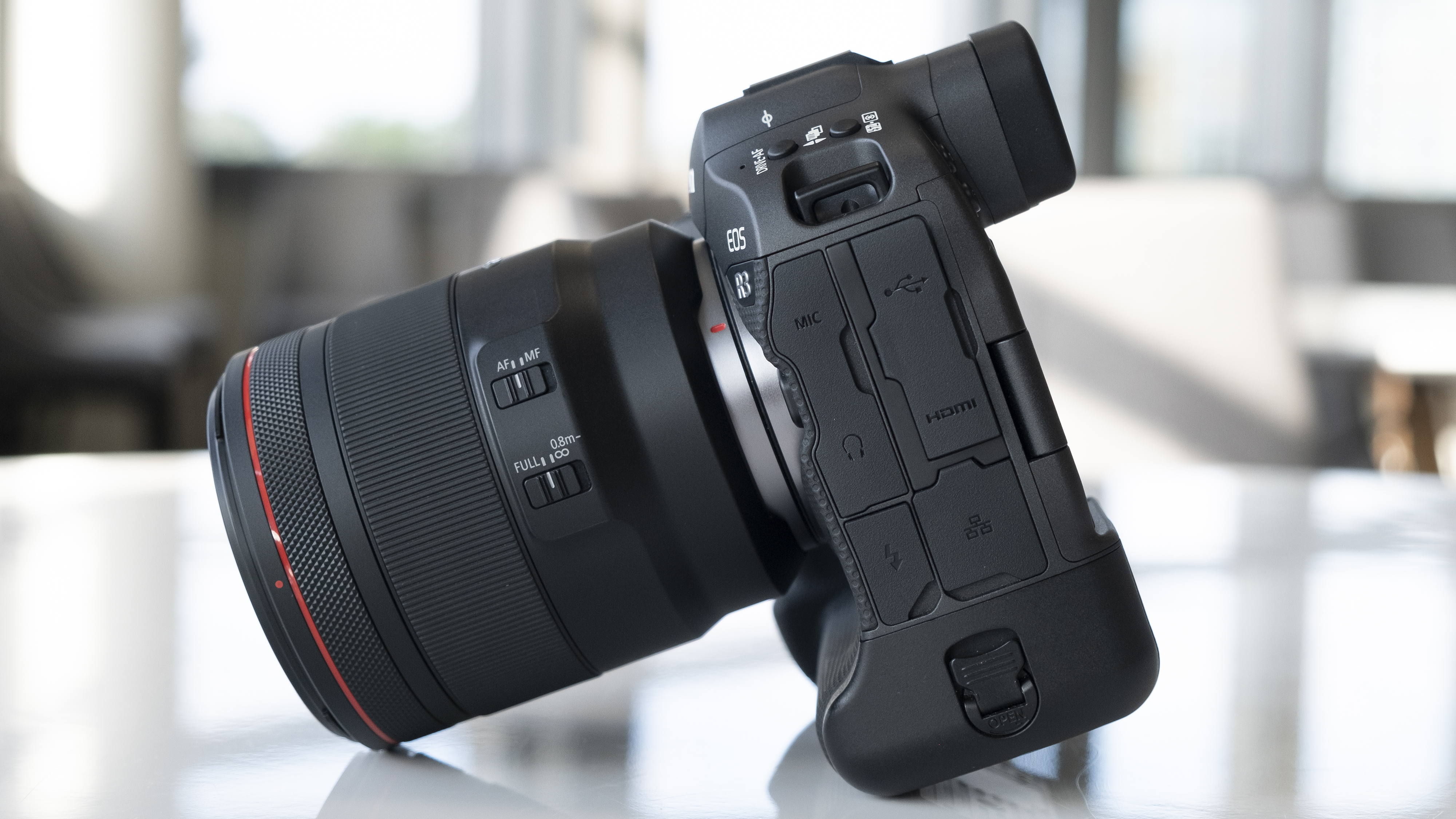 The side of the Canon EOS R3 mirrorless camera on a table