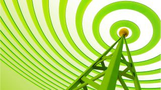 a green tower emits green radio waves