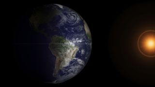 NOAA's GOES-13 satellite captured this image of the Earth at the spring equinox, this morning (March 20, 2013) at 7:45 a.m. Eastern Daylight Time.
