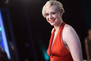 Gwendoline Christie in a red dress.