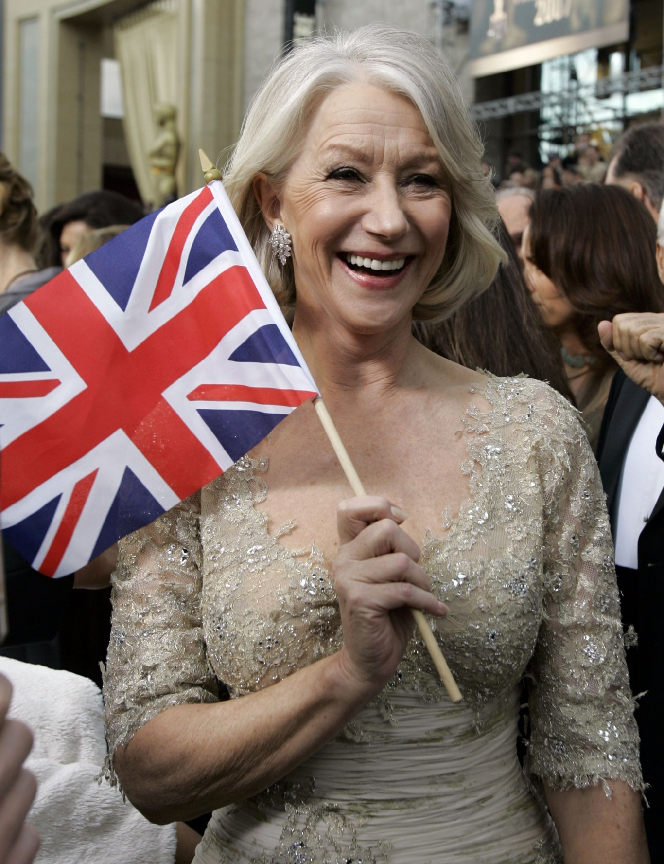 Helen Mirren waves a Union Jack flag on the red carpet at the 2007 Oscars