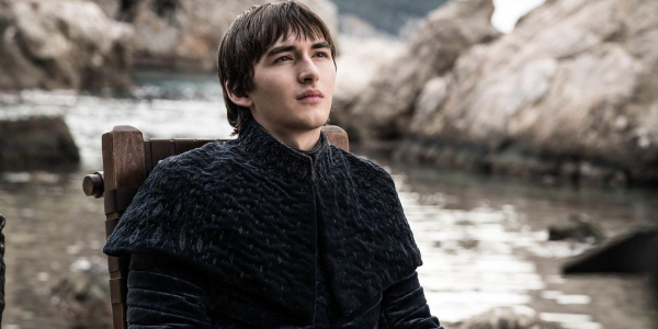 Game of Thrones Bran sitting on the dock, looking up regally