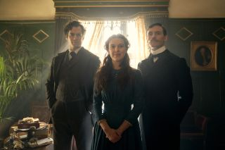 """Millie Bobby Brown, Henry Cavill and Sam Claflin in """"Enola Holmes"""" on Netflix."""