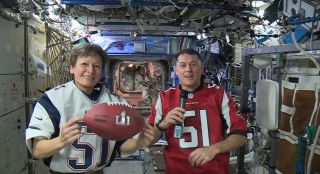 NASA astronauts Peggy Whitson (left) and Shane Kimbrough talk Super Bowl LI and life in space in this video still from a live NASA event on Feb. 1, 2017. The astronauts will watch the 2017 Super Bowl from space.