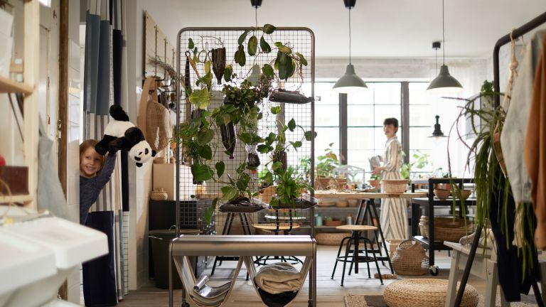 wire rack with house plants displayed in kitchen by ikea