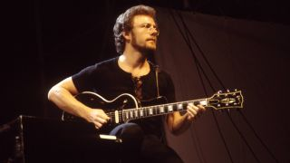 Photo of KING CRIMSON and Robert FRIPP; Robert Fripp performing live on stage, playing Gibson Les Paul guitar