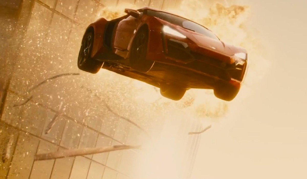 Car bursting out of building Furious 7