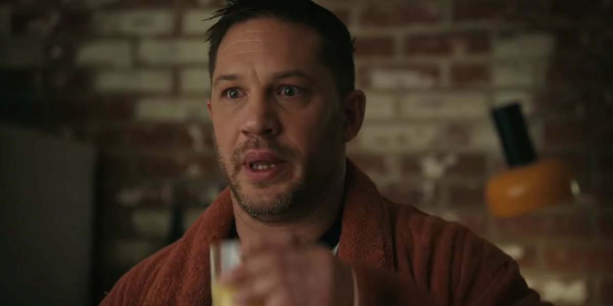 Tom Hardy looking anxious at breakfast in Venom Let There Be Carnage.