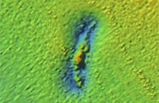 A sonar image from 2015 shows an outline of the U.S. Coast Guard cutter called the McCulloch.