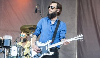 Creighton Barrett (left, background) and Ben Bridwell of Band of Horses perform during the 2021 Railbird Festival at Keeneland Racecourse on August 29, 2021 in Lexington, Kentucky