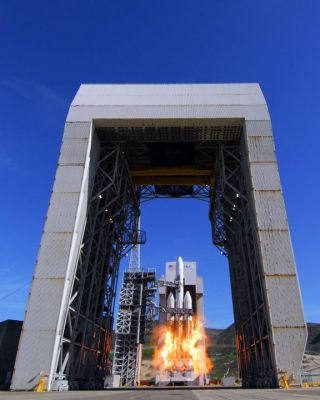 The secret NROL-49 spy satellite blasts off from Vandenberg Air Force Base in California atop a huge Delta 4-Heavy rocket in this photo taken at 1:10 p.m. PST on Jan. 20, 2011.