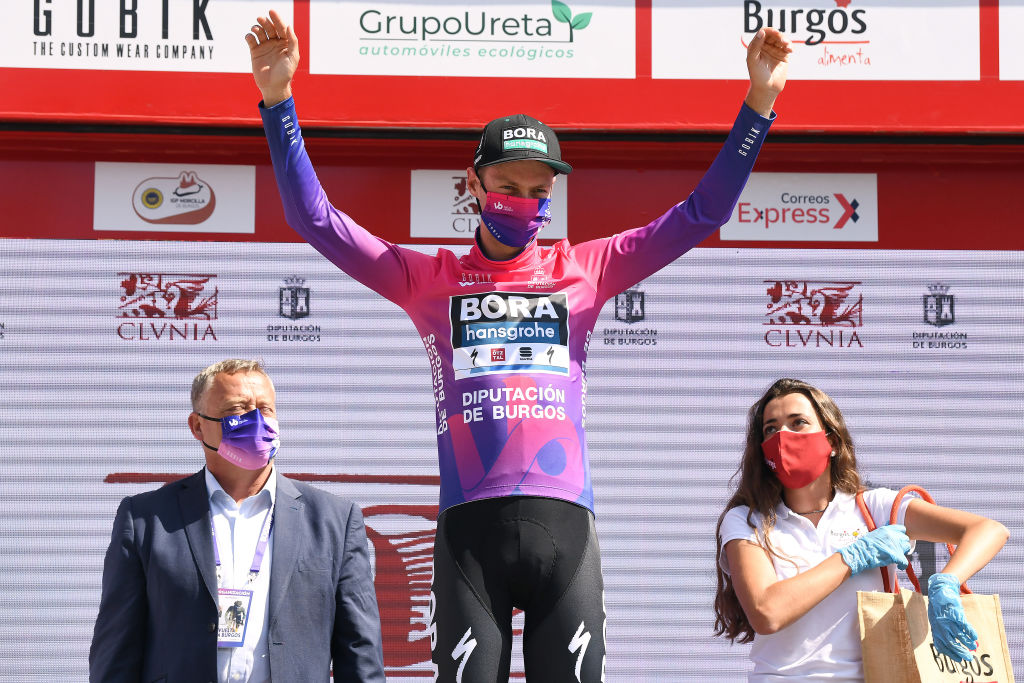 VILLADIEGO SPAIN JULY 29 Podium Felix Grossschartner of Austria and Team BoraHansgrohe Purple Leader Jersey Celebration Hostess Miss during the 42nd Vuelta a Burgos 2020 Stage 2 a 168km stage from Castrojeriz to Villadiego VueltaBurgos on July 29 2020 in Villadiego Spain Photo by David RamosGetty Images