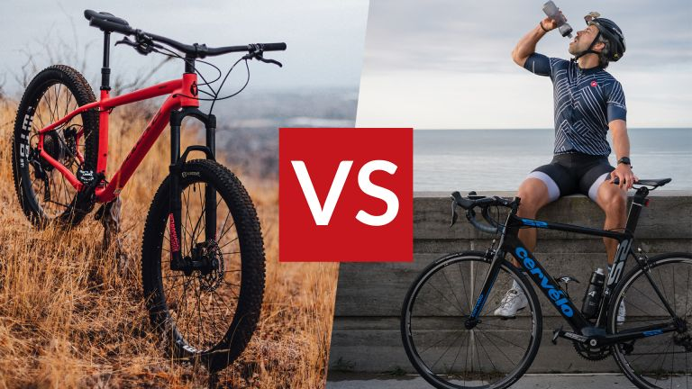 Mountain bike on the left, road bike on the right, VS sign in the middle