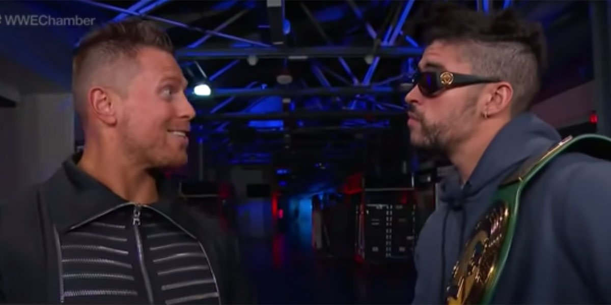 Bad Bunny and The Miz staring each other down.