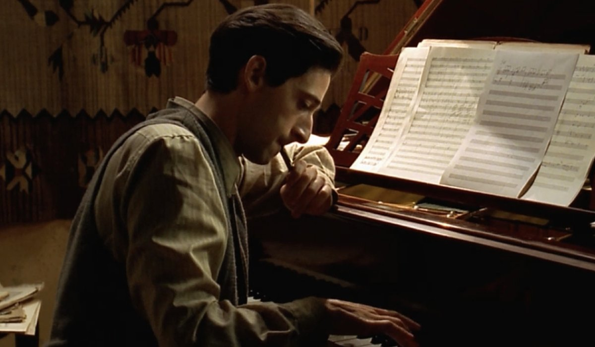 Adrien Brody composes a song at his piano in The Pianist.