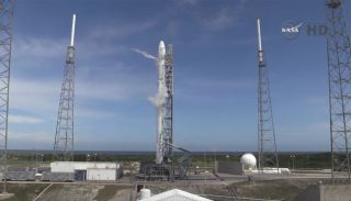 SpaceX's Falcon 9 rocket stands poised to launch a Dragon spacecraft from Cape Canaveral Air Force Station in Florida on April 13, 2015 on a mission to deliver NASA cargo to the International Space Station. It is SpaceX's sixth cargo mission for NASA.