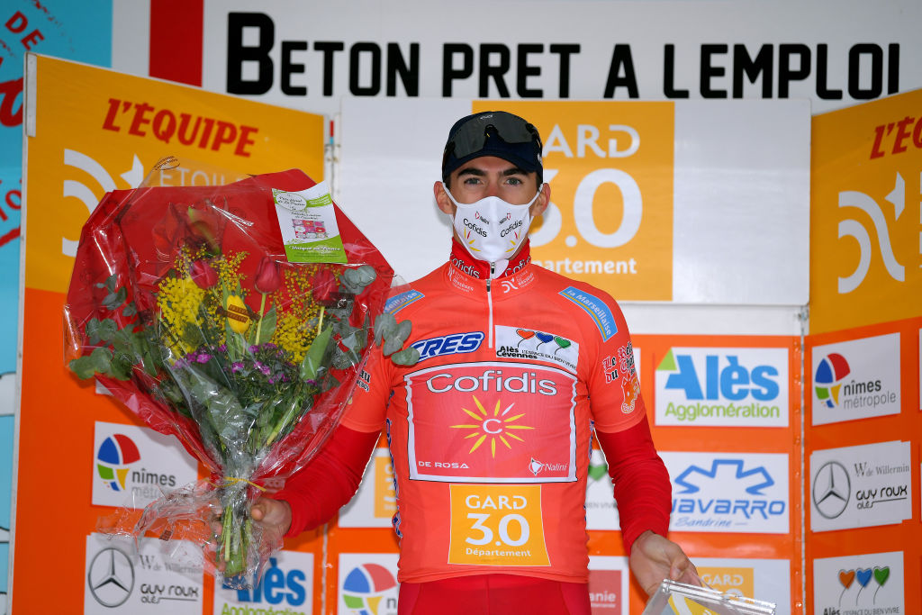 LA CALMETTE FRANCE FEBRUARY 04 Podium Christophe Laporte of France and Team Cofidis Solutions Credits Orange Leader Jersey celebrate during the 51st toile de Bessges Tour du Gard 2021 Stage 2 a 154km stage from SaintGenis to La Calmette Mask Covid safety measures Trophy Flowers EDB2020 on February 04 2021 in La Calmette France Photo by Luc ClaessenGetty Images