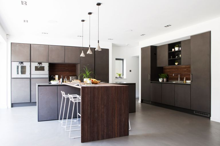 modern handleless dark kitchen with wooden breakfast bar