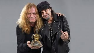 Dave Mustaine and Phil Campbell pose with an award at the Golden Gods 2016