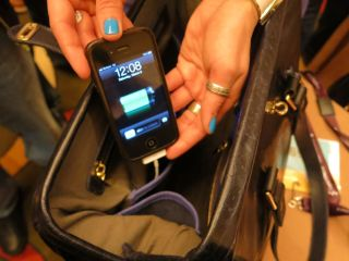 A purse that is wired to charge a phone