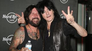 Tracii Guns and Phil Lewis in 2015