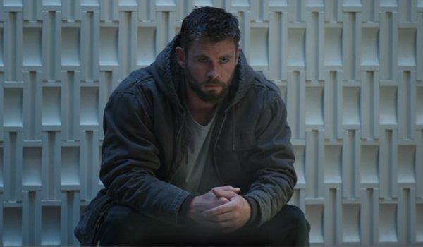 Avengers: Endgame Thor huddled in upset on a bench