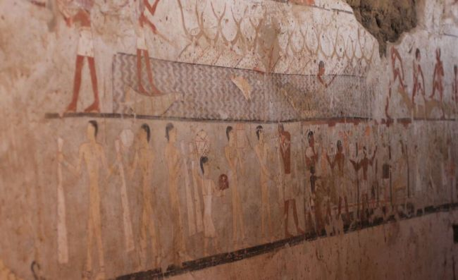 In this tomb scene, men can be seen herding or corralling cattle and people are carrying a variety of goods.