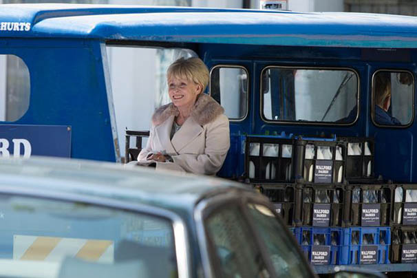 Peggy-takes-a-trip-on-the-back-of-the-milk-float.jpg