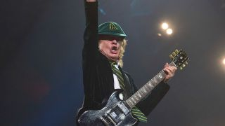 A picture of Angus Young performing live