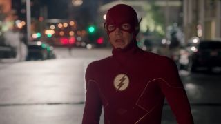 Grant Gustin as The Flash looking down road