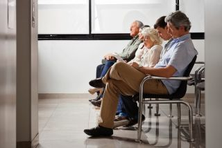 A number of people in the hospital's waiting room.