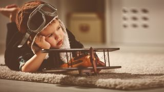 Little boy with toy airplane