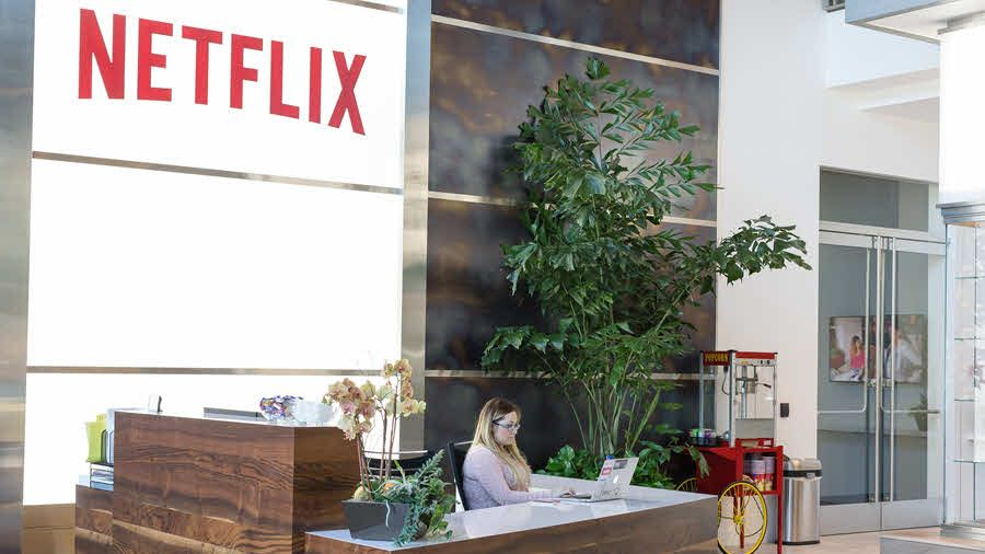 netflix stock jumps as higher rates announced