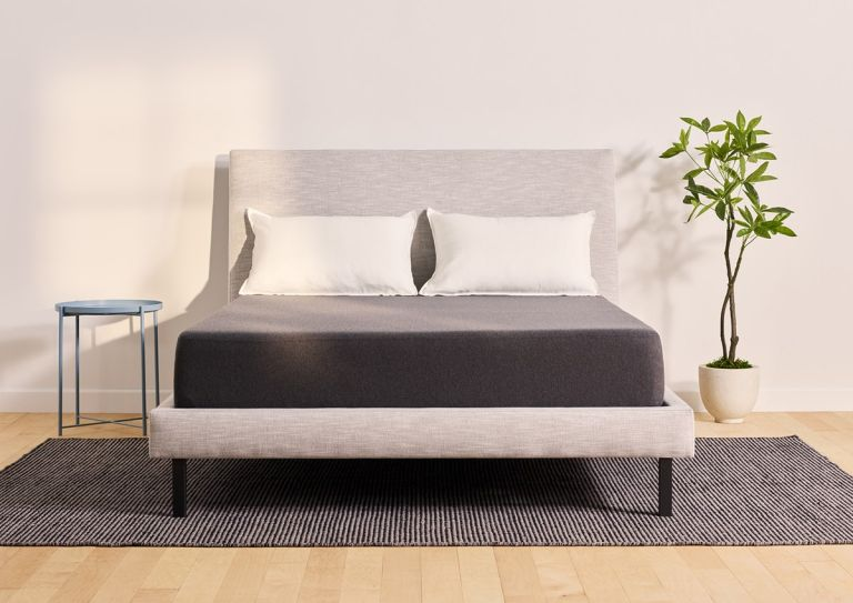 Casper mattress in bedroom on bed with plant